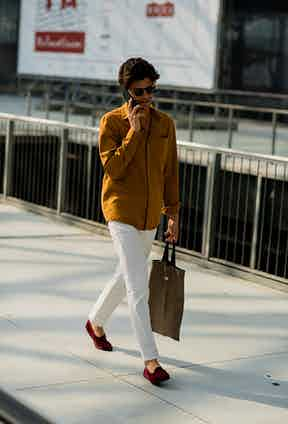 Cropped white pencil trousers - due to the narrow fit, a cropped length works better than a turn-up, which would only add bulk to the bottom of the legs, when in fact a slender silhouette is the goal.