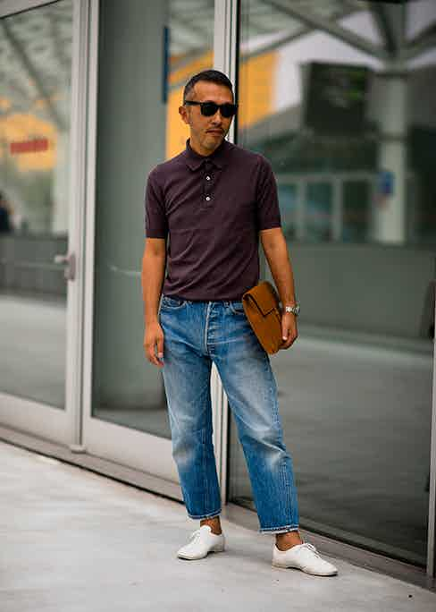 Cropped jeans typically work best with a few rolls above the ankle, but this gentleman has opted for a cropped jean to begin with and has added just a single subtle turn-up. Note, these jeans have a twisted seam, which allows for a better drape when cropped.