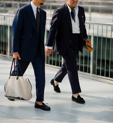 Classic navy suits stride into the modern world with an elegant turn-up and loafers. If you want to stand out in the office, you needn't go crazy or garish.