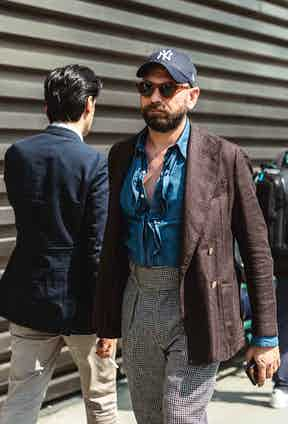 A denim shirt can be an opportunity to introduce texture such as ruffles and pleats. By co-ordinating the colours of your top half carefully, you can introduce an understated pattern via your trousers.