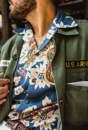 Nathaniel Asseraf of Broadway & Sons wears muted tones of blue and green combined with florals for an instant casual classic.