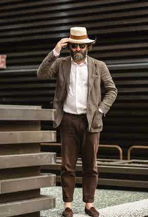 A well-chosen hat can add a hint of sprezzatura and complete a tonal gradient.