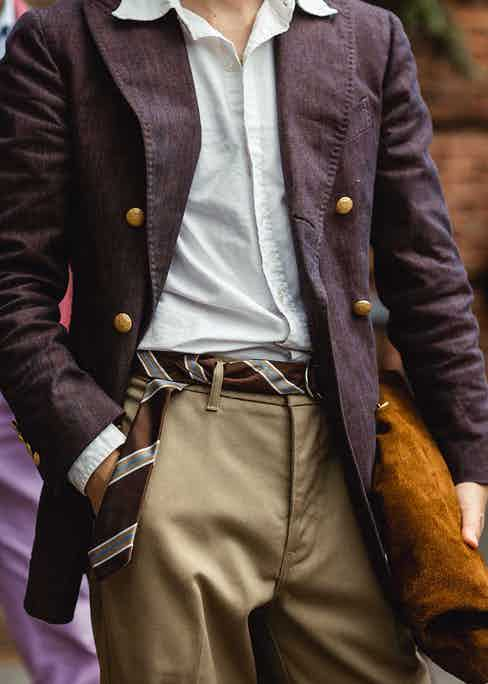Repurposing a tie as a belt is a maverick way to add a hint of playfulness to your suit trousers.