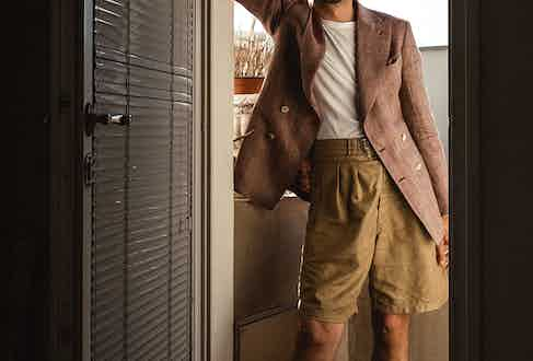 A pair of wide-leg Bermuda shorts can put a totally fresh spin on your overall silhouette when paired with a double-breasted jacket and T-shirt.