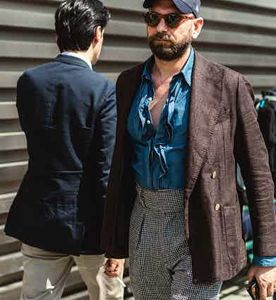 Mixing cuts, colours and materials is a surefire way to liven up your look, but tread carefully: it takes a special confidence to pull off a cobalt blue ruffled shirt with the top three buttons undone.
