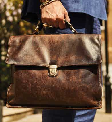 """Prior to joining Anderson & Sheppard, he needed a suitable briefcase. He can't recall where he got it from but it has """"been through the wars with me"""", he says."""