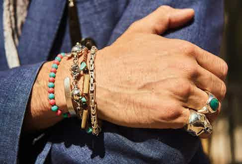 As a reference to his love of rock 'n roll, Karl is never seen without a fair amount of jewellery, mainly from The Great Frog. He favours silver over gold, and here wears a beaded bracelet made by his daughter when holidaying in Ibiza a few years ago.