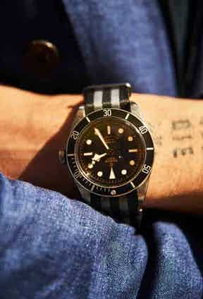 """Karl is wearing a Tudor Black Bay diver's watch with a NATO strap. """"I can chuck it around and it fits my way of life,"""" he says."""