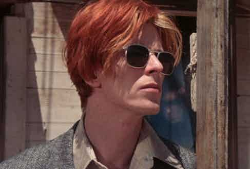Bowie sported a blonde and flame orange wedge haircut with a neat centre parting for his role as Thomas Jerome Newton.