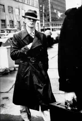 Bowie wearing a trench coat outside court, where he was answering drug charges in 1976.