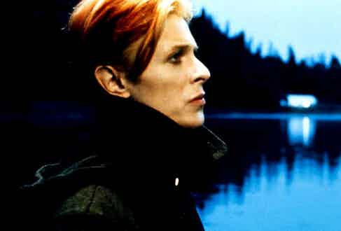 Bowie's ghostly, androgynous features contrast beautifully with the stern black duffle coat he wore for the film.