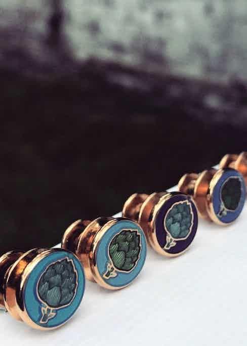 Artichoke pins in a range of rich colours.