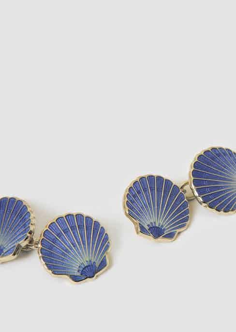 A pair of Codis Maya's scallop cufflinks.