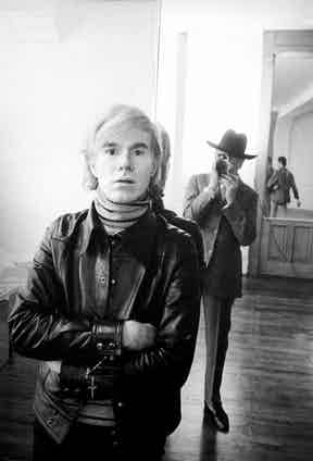 A leather jacket and striped polo neck sweater were staples of Warhol.