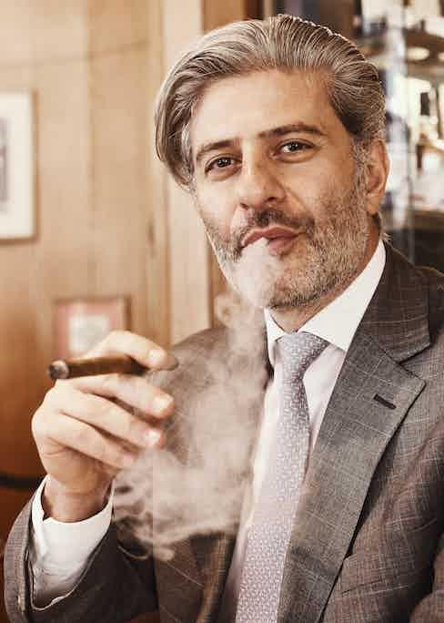 Eddie Sahakian, proprietor of Davidoff of London, enjoys a Davidoff 3000 slim guage panatella.