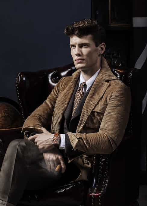 """Bellytanker """"Dusty"""" Chronograph, Bell & Ross X The Rake and Revolution; brown cotton corduroy jacket, and brown wool sport jacket, both Ring Jacket; white cotton shirt, and olive cotton twill trousers, both Ermenegildo Zegna; brown geometric-print silk tie, Mariano Rubinacci."""