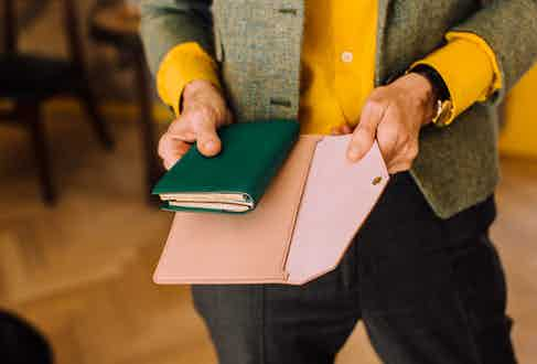 Anda's forest green diary is from Hermes, and perfectly complements the soft pink of her card holder, which is from Alexandra Foulkes' company Innis.