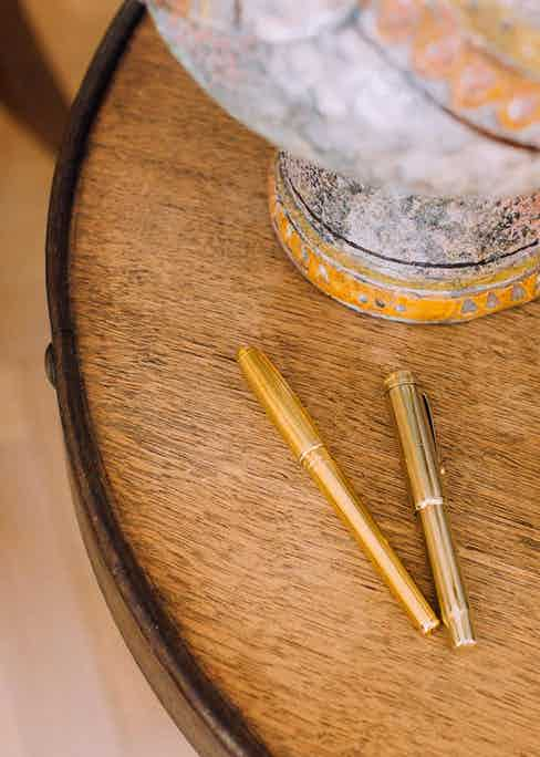 """Anda inherited this gold Parker pen from her father, but travels with the DuPont cartridge pen to avoid leaking. """"I learnt to write at the French school, so my handwriting is very curly, which looks much better with an ink pen."""""""