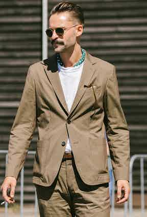 When wearing a bandana with a T-shirt and tailoring, keep it tucked in for a neater finish.
