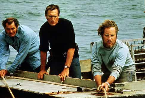 Brody's look is slick compared to Quint and Hooper's seafaring style.