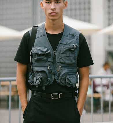 A utility vest puts a very modern military twist on a simple black T-shirt.