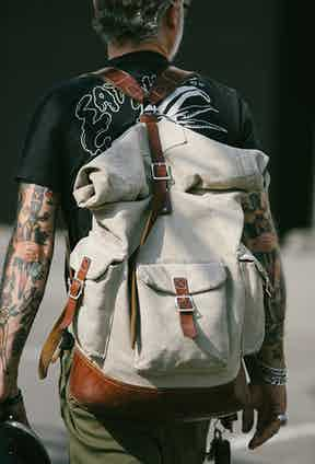 A classic roll-top rucksack is an excellent way to add some vintage ruggedness to your personal style.