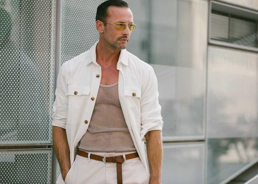This gentleman shows how effective a crisp white overshirt can be when worn with beige and tan hues.