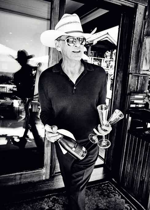 Black knitted cotton long-sleeved polo shirt, Tom Ford at Mr Porter; black wool trousers, Brioni. Straw hat and sunglasses, property of Pierce Brosnan.