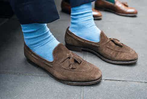 """Northampton-based Crockett & Jones is one of Marvin's favourite shoemakers, of which he has a number of pairs. """"I think they're great value shoes — well-constructed, comfortable and have great leather uppers."""" These tassel loafers are crafted from chocolate brown suede, complemented by baby-blue socks."""