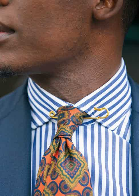 Palmer picked out this vibrant orange and gold tie from E.G. Cappelli in Naples, with the help of owner Patrizio Cappelli. The pattern clashes subtly with his blue-candy-striped shirt and gold collar-pin, which he surreptitiously 'borrowed' from his mother.