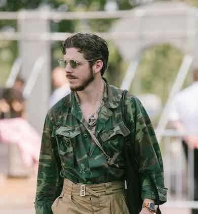 Photographer Robert Spangle embellishes his military garb with a nonchalantly slung bandana.