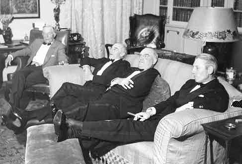 A group of gentlemen put their feet up after dinner following the day's shoot.