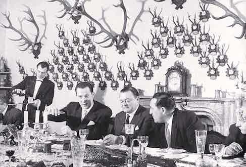 Czech premier Klement Gottwald at a dinner party after a pheasant shoot.
