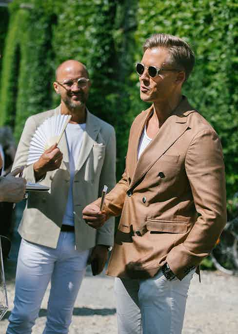 The white T-shirt subtly dresses down summer suiting while still looking as crisp, if not as formal, as a collared shirt.