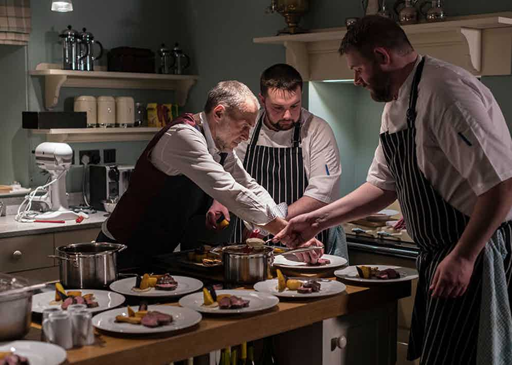 Michel Roux Jr plates up the main course of the Craftsman's Dinner.