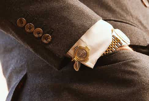 The gold and silver combination makes for an excellent complement to business or dress watches.
