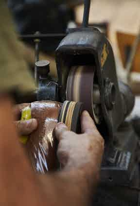 One of the finishing steps that takes place across the range is the sanding down of heels, pictured here, a country brogue.