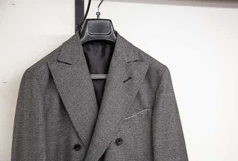 The jacket is cut in the Neapolitan way with a spalla a camicia shoulder.