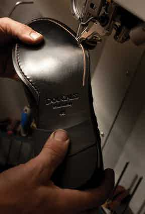 Hand-finishing a pair of Doucal's shoes ensures the highest levels of quality.