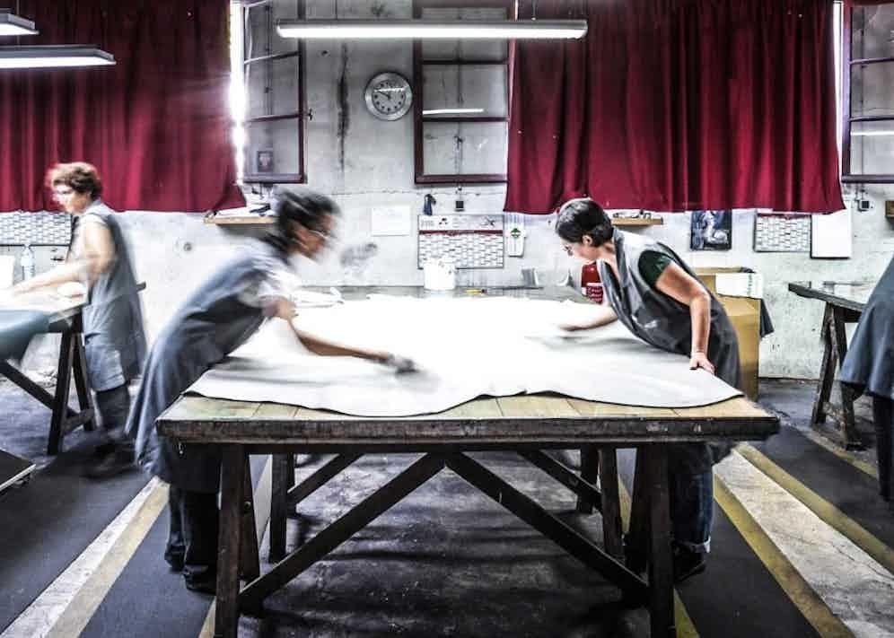 Highly skilled artisans at work in Dalgado's family-run Italian factory.