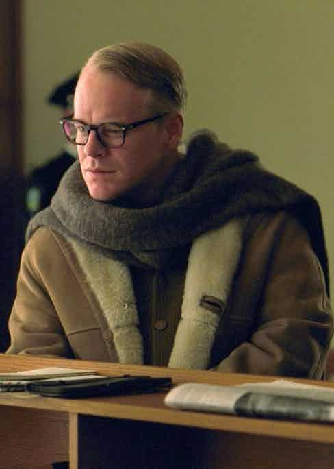 The perfect marriage of shearling coat and thick woollen scarf.