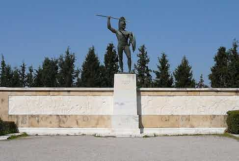 """Leonidas monument at Thermopylae; """"Molon Labe"""" is inscribed at its base."""