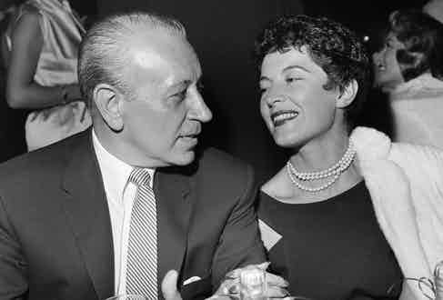 Raft and his wife, Grace Mulrooney, at the opening of the Moulin Rouge in Los Angeles, 1957. Photograph by Getty Images.