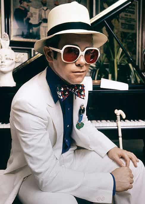 Elton John wears a Nutters of Savile Row suit.