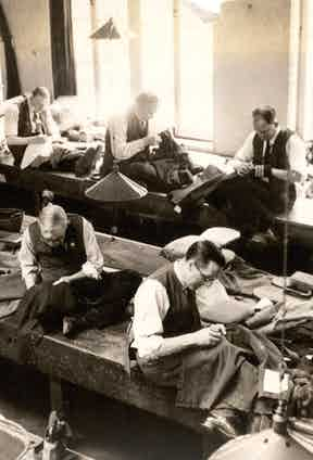 Tailors at work in the Henry Poole cutting room.