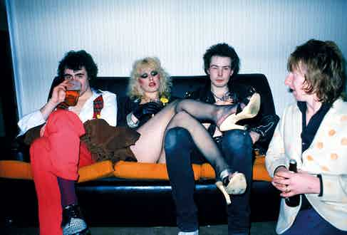 Glen Matlock, Nancy Spungen, Sid Vicious and Rat Scabies in London, 1978. Photograph by Getty Images.