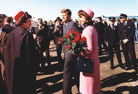 Mr. and Mrs. Kennedy arrive in Dallas on the day of his assassination, 1963 (Photograph by Cecil Stoughton/The White House)