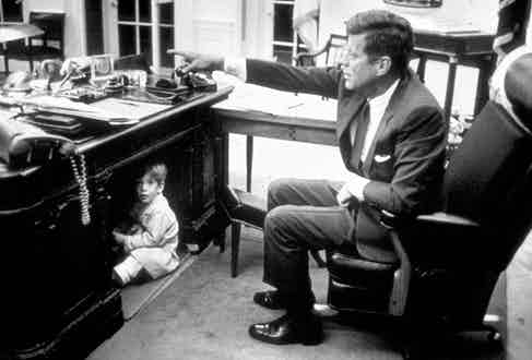 Kennedy and his son John Kennedy Jr. in the Oval Office, 1963 (Photo via Getty)