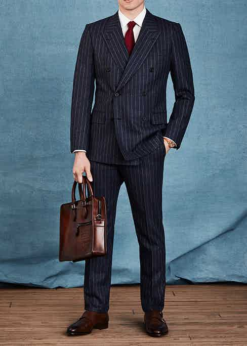 Mr Porter's business look features a timeless double-breasted navy blue pinstripe suit which beautifully offsets the tan elements of the watch.
