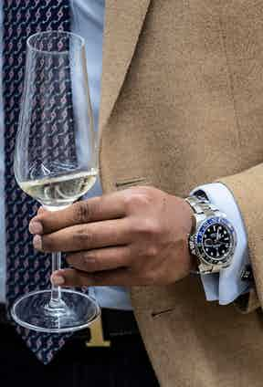 Cashmere blazer, champagne and Rolex - a holy trinity if ever there was one.